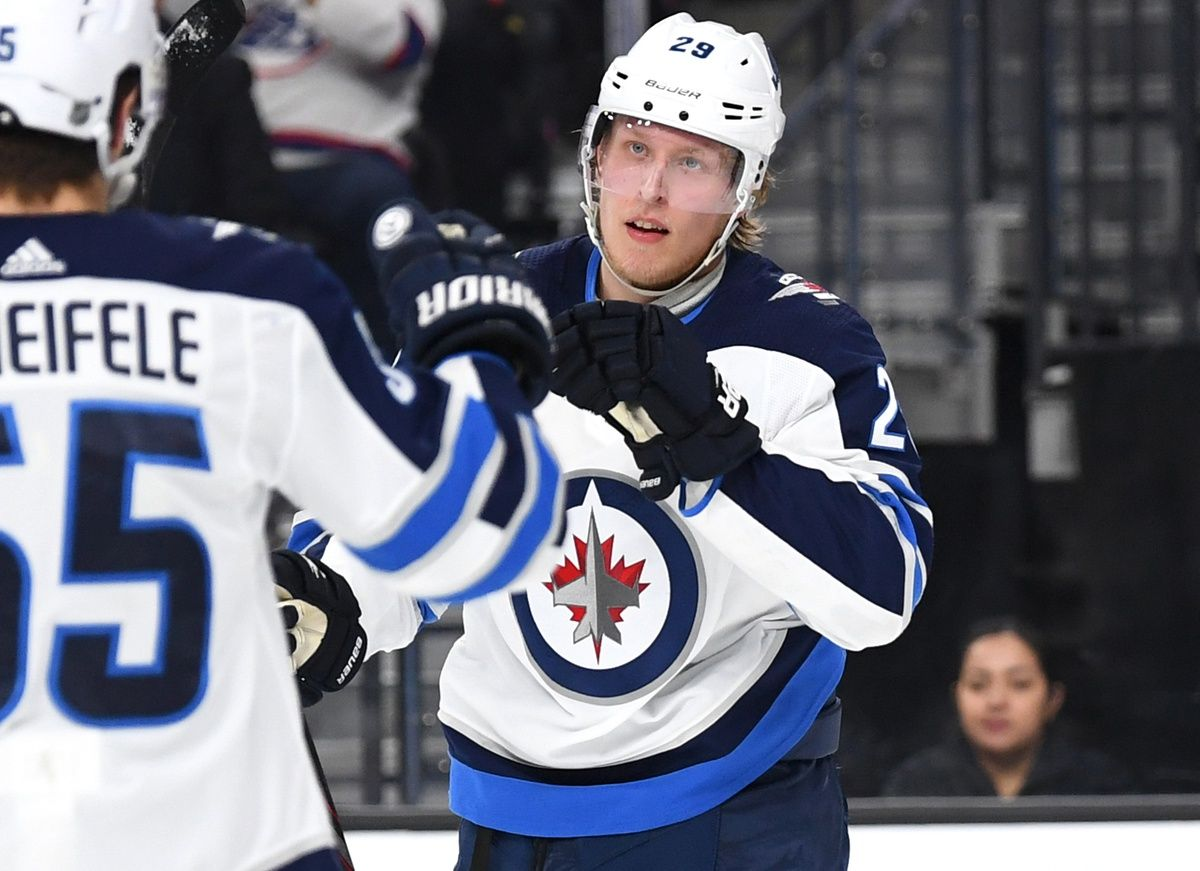 Picture for question *YOU'RE THE GM:* Of the two notable RFAs the Jets have on offense - Patrik Laine and Kyle Connor - how do you handle their upcoming contracts? Do you sign them to long term (pricey, 5+ years) or bridge (cheaper, 2 year or less) contracts? If you sign both long term, do you trade away players like Perreault, Trouba or Byfuglien to help make room in the cap?