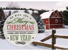 Merry Christmas and Happy New Year with red barn and pines in the background with snow